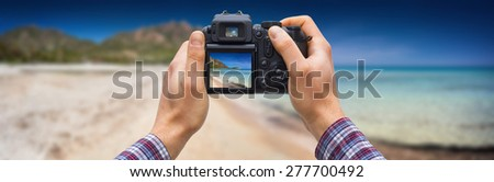 DSLR camera in hands shooting seascape - these are all photos made by me, that you separately can find on my shutterstock portfolio. Logos, brand, or anything has been deleted to be 100% commercial.   - stock photo