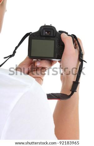 dslr camera in male hands over white - stock photo