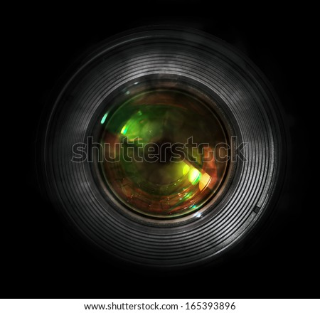 DSLR camera lens, front view, black background. - stock photo