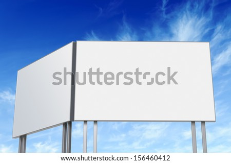 Dual billboard with empty screen, against blue sky  - stock photo