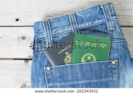 Dual citizenship blue collar worker concept with a jeans and two passports - stock photo