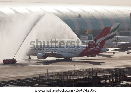 DUBAI - APRIL 1: Inaugural flight of Qantas to Dubai as seen on April 1, 2013. Qantas has now codeshare with Emirates. - stock photo