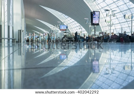 DUBAI - APRIL 06: Passenger lobby in Dubai International Airport on April 6, 2016 in Dubai, UAE.  It's world largest building by floor space and world largest airport terminal. - stock photo
