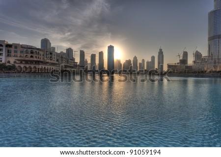 Dubai city at sunset - stock photo