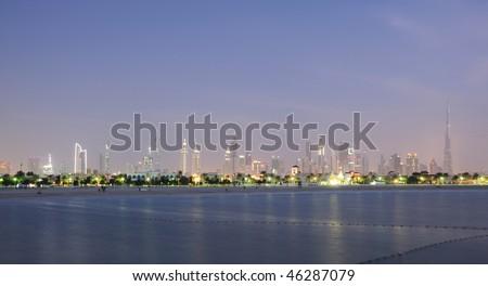 Dubai City Skyline at dusk. Jumeirah Beach Park in the Foreground. United Arab Emirates - stock photo
