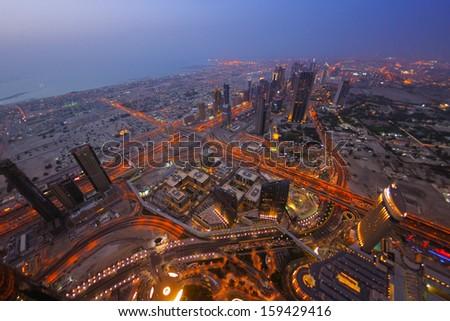 dubai city skyline   main road and new skyscrapers at sunset - stock photo