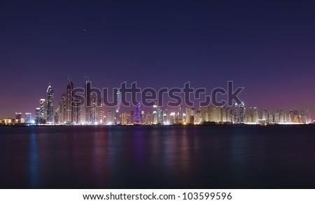 Dubai cityscape in the night - stock photo
