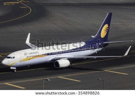 DUBAI - DECEMBER 5: A Jet Airways B737-800 is taxing to the gate after arrival from India as seen on December 5, 2015. - stock photo