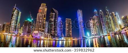 Dubai downtown night scene. Modern skyscrapers in Dubai  in a summer night - stock photo
