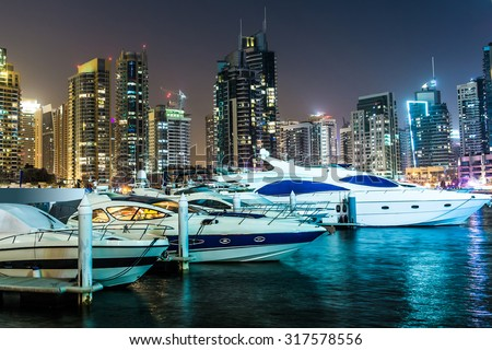 Dubai downtown night scene with city lights, luxury new high tech town in middle East. Dubai Marina cityscape, UAE. - stock photo