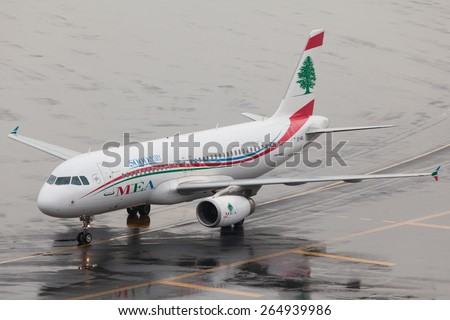 DUBAI - FEBRUARY 2: A Lebanese plane is taxiing to the gate after her arrival on a rare rainy day as seen on February 2, 2013. Dubai airport's traffic is very heavy in the mornings. - stock photo