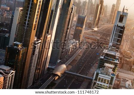 Dubai from above. Dubai skyline on sunset. United Arab Emirates - stock photo