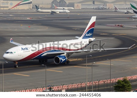 DUBAI - JANUARY 9: A Nigerian Airbus A330 of Arik Air is taxing to the gate after arrival at Dubai International Airport as seen on January 9, 2015. - stock photo