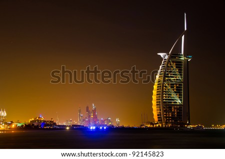 DUBAI - JANUARY 4: Burj al Arab hotel, one of the few 7 stars hotel in the world and one of the most recognized luxury symbol at night on JANUARY 4, 2012 in Dubai, United Arab Emirates - stock photo
