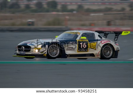 DUBAI - JANUARY 14: Car 16, a Mercedes SLS AMG GT3, competes during the morning hours of the 2012 Dunlop 24 Hour Race at Dubai Autodrome on January 14, 2012.