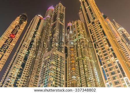 Dubai - JANUARY 10, 2015: Marina district on January 10 in UAE, Dubai. Marina district is popular residential area in Dubai - stock photo
