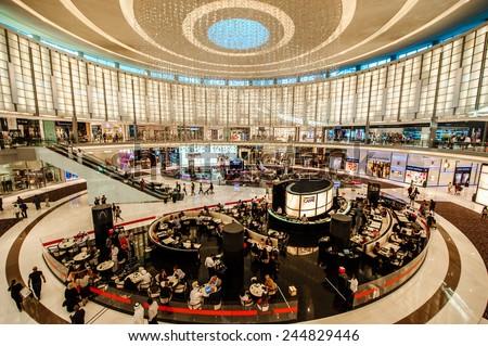 DUBAI - JANUARY 05: The Dubai Mall linterior on January 05, 2015 in Dubai, UAE. The Dubai Mall located in Dubai, it is part of the 20-billion-dollar Downtown Dubai complex, and includes 1,200 shops. - stock photo