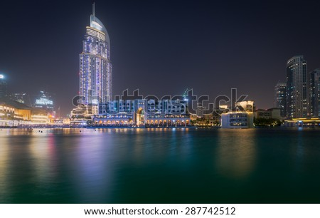 Dubai - June 4 : Dubai Fountain show area near Dubai mall, Souk Al Bahar and Burj Khalifa the tallest building in the world on June 4,2015 in Dubai. - stock photo