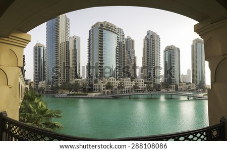 Dubai - June 5 : Lake near Dubai mall, Burj Khalifa view from Souk Al Bahar on June 5, 2015 in Dubai. - stock photo