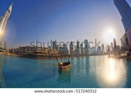 Dubai lagoon with boat against sunset in United Arab Emirates