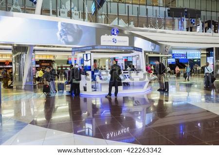DUBAI - MARCH 14, 2016: Info centre in Dubai International Airport, UAE.  It's world largest building by floor space and world largest airport terminal. - stock photo