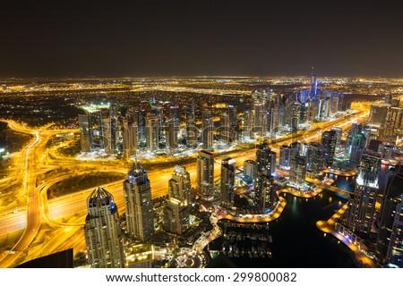 Dubai Marina by night.Aerial view Dubai Marina. The Torch Tower.Dubai Marina skyscrapers.Dubai marina rooftop view.Dubai luxury homes.Dubai Emaar properties buildings.Dubai Jumeirah lakes towers - stock photo