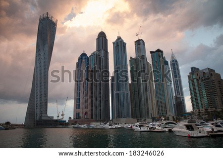 Dubai Marina district, business and dining area of Dubai City with famous buildings at background - stock photo