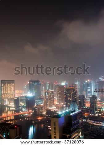 Dubai Marina on a Cloudy Night - stock photo