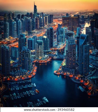 Dubai Marina rooftop skyline by night. United Arab Emirates. Travel background. - stock photo