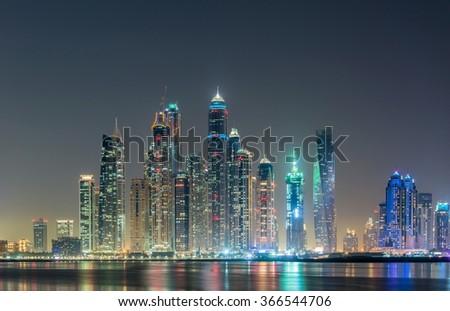 Dubai marina skyscrapers during night hours - stock photo