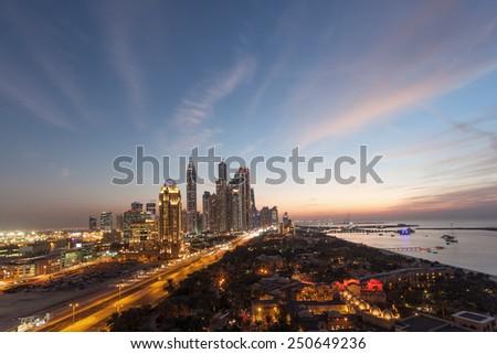 Dubai Marina Towers and Arabian Gulf coast at night. Dubai, United Arab Emirates - stock photo