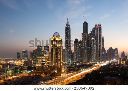 Dubai Marina Towers illuminated at night. Dubai, United Arab Emirates - stock photo