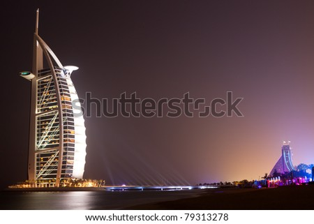 DUBAI - MAY 12: Burj al Arab hotel, one of the few 7 stars hotel in the world and one of the most recognized luxury symbol at night on MAY 12, 2011 in Dubai - stock photo