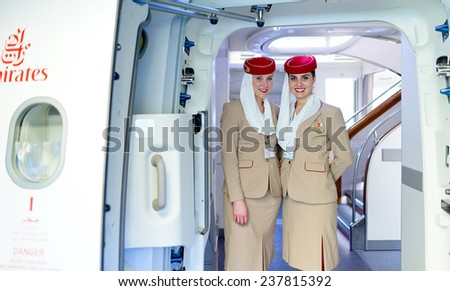 DUBAI - MAY 16: Emirates crew members meet passengers in Airbus A380 aircraft on May 16, 2014 in Dubai, UAE. Emirates handles major part of passenger traffic and aircraft movements at the airport. - stock photo