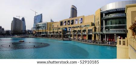 DUBAI - MAY 12 : External view of Dubai Mall from Burj Khalifa alongside the famous water fountain in Dubai downtown on May 12, 2010 in Dubai, UAE. - stock photo