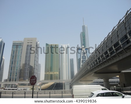 Dubai - metro and air-conditioned walkway above the main street.