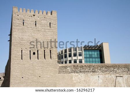 Dubai museum contrasted with newer building - stock photo