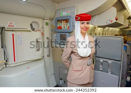 DUBAI - NOV 12: Airbus A380 crew member on November 12, 2014 in Dubai, UAE. Emirates handles major part of passenger traffic and aircraft movements at the airport. - stock photo