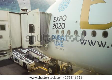 DUBAI - NOV 12: docked Airbus A380 aircraft on November 12, 2014 in Dubai, UAE. Emirates handles major part of passenger traffic and aircraft movements at the airport. - stock photo