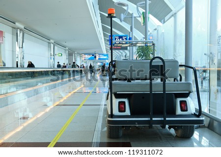 DUBAI - NOVEMBER 10: Battery operated cars in airport on November 10, 2012 in Dubai, UAE. The airport is major aviation hub in the Middle East with max throughput of 80 millions passengers per year