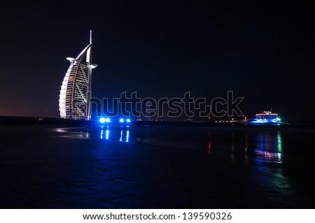DUBAI - NOVEMBER 11: Burj Al Arab and the 360 degrees club on November 11, 2011 in Dubai, United Arab Emirates. Burj Al Arab is a luxury 5 star hotel built on a man made island 280 metres offshore. - stock photo