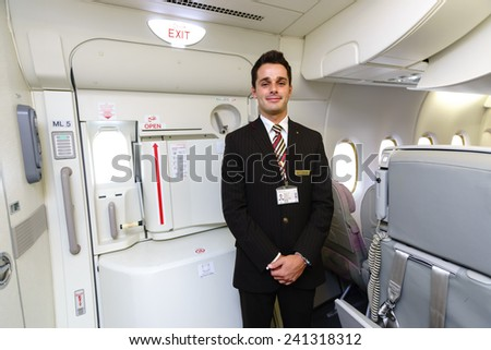 DUBAI - OCT 17: Emirates crew member in Airbus A380 aircraft on October 17, 2014 in Dubai, UAE. Emirates handles major part of passenger traffic and aircraft movements at the airport. - stock photo
