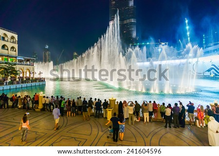 DUBAI - OCT 15: The Dubai Fountain on October 15, 2014 in Dubai, UAE. The Dubai Fountain is the world's largest choreographed fountain system set on the 30-acre manmade Burj Khalifa Lake - stock photo