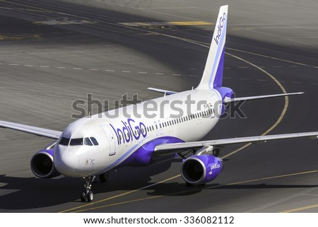 DUBAI - OCTOBER 29: An Indigo Air A320 is taxing to the gate after arrival from India as seen on October 29, 2015. Dubai airport's traffic is very heavy in the mornings. - stock photo
