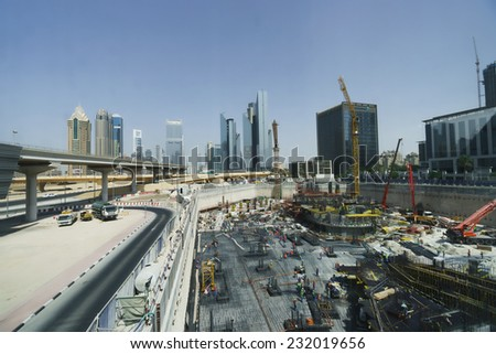DUBAI - OCTOBER 15: construction activity in Dubai downtown on October 15, 2014 in Dubai, UAE. Dubai is the most populous city and emirate in the United Arab Emirates  - stock photo