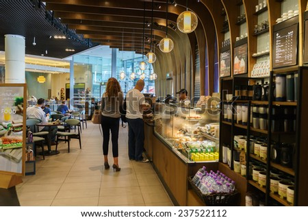 DUBAI - OCTOBER 15: Starbucks Cafe interior in the Dubai Mall on October 15, 2014 in Dubai, UAE. Starbucks is the largest coffeehouse company in the world, with more then 23000 stores - stock photo