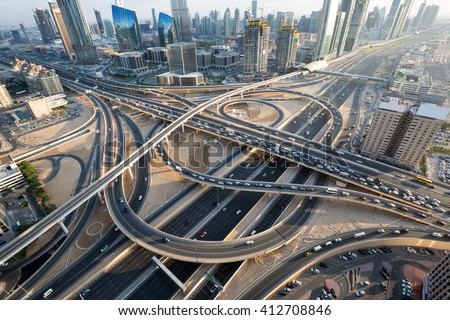 Dubai roads. Dubai crossroads. Dubai junction. Dubai intersection. Dubai car traffic. Dubai transport. Dubai highways. Dubai busy roads. Dubai Interchange 1. Dubai Sheikh Zayed road. Dubai traffic. - stock photo