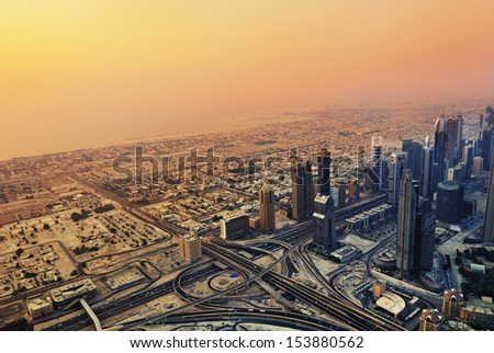 DUBAI - SEP 01: Dubai skyline along Sheikh Zayed Road at sunset on Sep 1, 2010,  Dubai, UAE. It is home to most of Dubai's skyscrapers, including the most tall hotel in the world Rose Rayhaan - stock photo