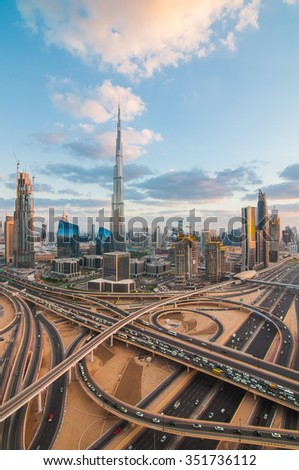Dubai skyline at dusk shows the Sky Scrapers of the Sheikh Zayed Road. - stock photo