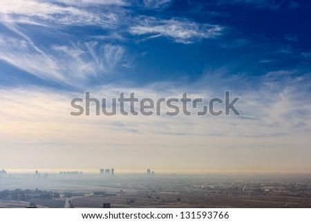 Dubai skyline, United Arab Emirates. Desert and city. - stock photo